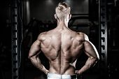 Handsome Power Athletic Man Diet Training Pumping Up Back Muscles poster