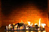 stock photo of cozy hearth  - beautiful cozy fireplace lit by the fire - JPG