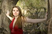 pic of pouty lips  - beautiful woman in red dress in forest - JPG
