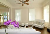 beautiful modern livingroom with white furniture and orchid