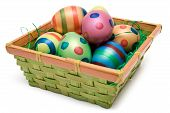 image of easter-eggs  - Colorful easter eggs in a wooden basket - JPG