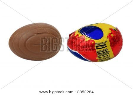 Wrapped And Unwrapped Easter Chocolate. Chocolate Eggs