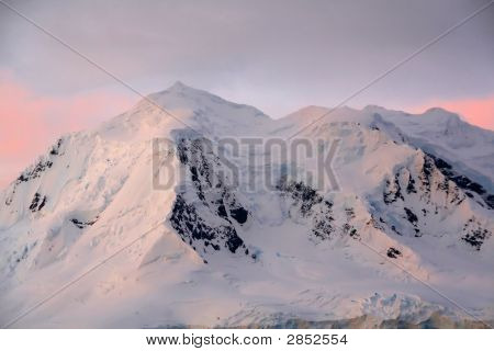 Subtle Alpenglow Lights Snowy Mountain