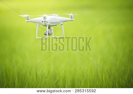 poster of Drone Copter Flying With Digital Camera, Flying Camera Take A Photo And Video With Professional Came