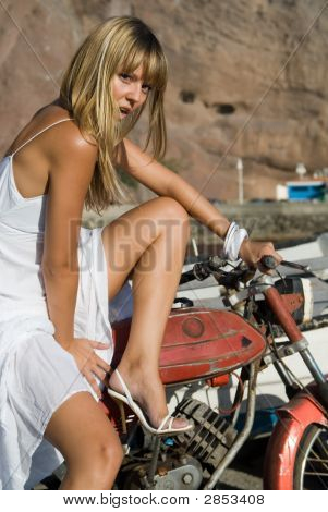 Blonde Girl With A Motocycle