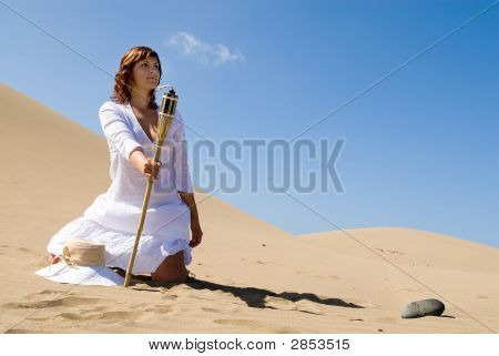 Woman With Light In The Desert