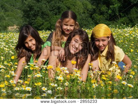 Happy Smiling Group Of Children Relaxing In Summer