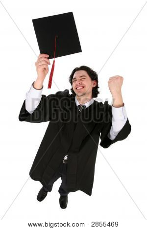Man In Graduation Robes Clenching Fists