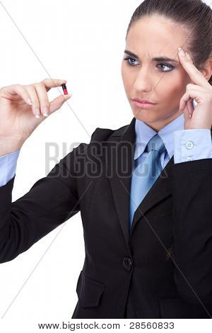 businesswoman with migraine looking in pill, isolated on white background
