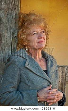 Thoughtful Middle Aged Woman In Rustic Setting