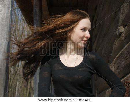 Teenage Girl Near Old Timber Wall