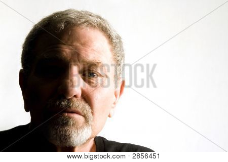 Close Up On The Face Of A Baby Boomer - Isolated