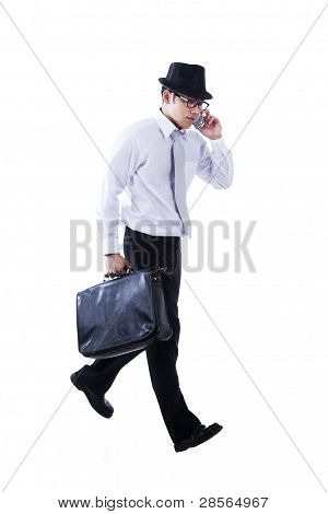 Businessman with fedora walking