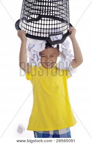 Boy Plays With Rubbish Bin
