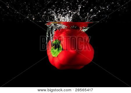 Red Pepper Splash Into Water