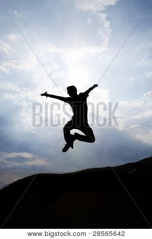 Silhouette Of Happy Man Jumping