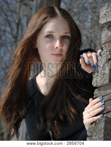Teenage Girl Near Old Timber Wall