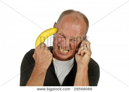 Man pointing his banana gun against his head while phoning