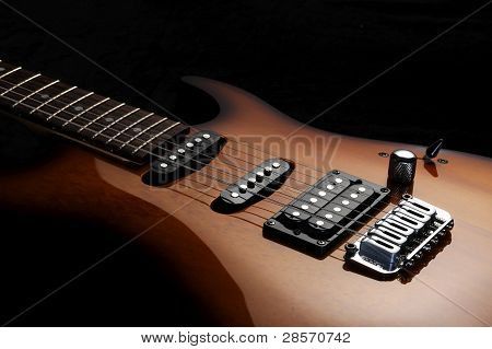 Close Up Of A Electric Guitar On Dark Background