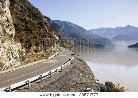 tibet: road along lake