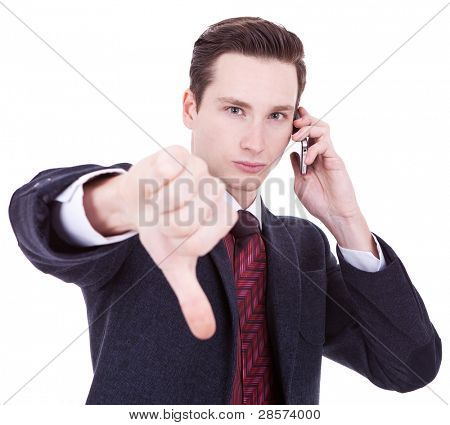 Business man with bad news on his cell phone disapproving