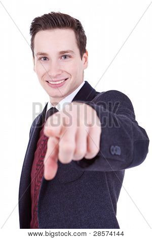 Young business man in a suit, pointing at camera