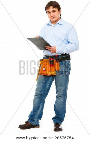 Full Length Portrait Of Construction Worker With Clipboard