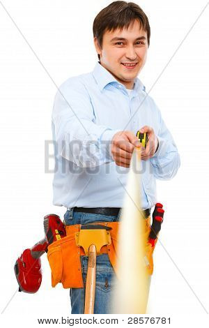 Construction Worker Holding Ruler That Going Into The Distance