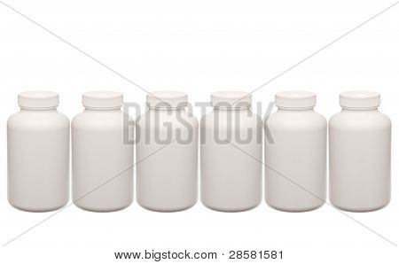 White Pills Containers In A Row Isolated On White