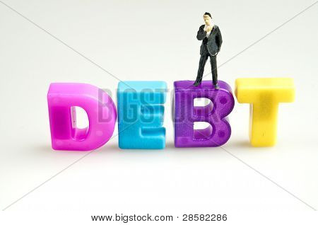 Debt word and toy business man