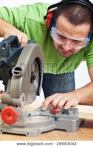 Carpenter Or Joiner Working With Power Tool