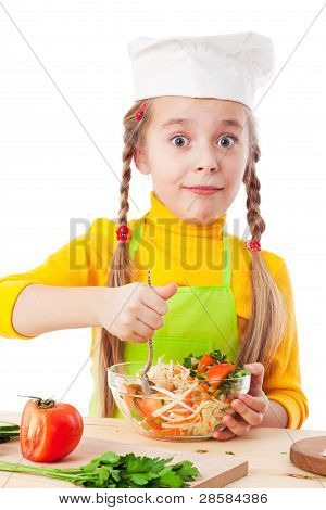 Little chef mix the salad