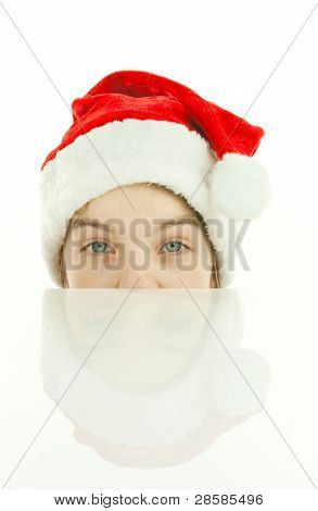 Pretty Santa Girl, Closeup Portrait Of A Teen Girl Wearing Christmas Hat Isolated Over White Backgro