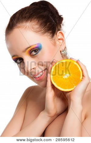 Beautiful Young Woman With Fresh Orange.