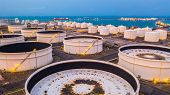 Storage Tanks And Oil Terminal In Petrochemical Terminal Port. poster