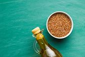 Flax seeds, linen seeds or linseeds and oil. Top view. poster