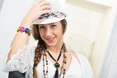 Portrait Of A Beautiful Hippie Girl With Summer Hat poster