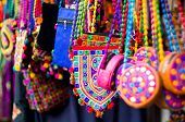Colorful, Textile, Hand Made Hand Bags Hanging In A Shop In Gujarat poster