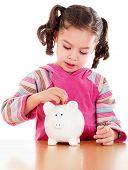 stock photo of cute little girl  - Stock image of little girl learning the value of saving - JPG