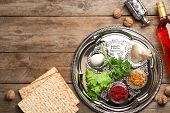Flat Lay Composition With Symbolic Passover (pesach) Items On Wooden Background, Space For Text poster