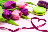 Heart Shape Made Of Purple Ribbon; Purple And Green Macaroons, Bouquet Of Purple And Pink Tulips On  poster