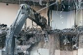 Close Up Photo Of Building Demolition Excavator/destruction Of A Building, House Ruins, Reconstructi poster