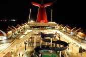 foto of cruise ship  - night time exposure of cruise ship main deck  - JPG