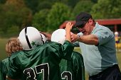 foto of motivation talk  - The football coach is talking to his players on the sidelines - JPG