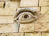 Sculpted eye on a wall