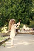 Small Child With Long Hair Play Outdoor. Happy Girl In Summer Park. Fashion Kid Have Fun. Summer Act poster