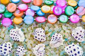 Sea Shells And Colorful Pearl Beads On Crystals Of Aromatic Bath Sea Salt For Spa May Use As Backgro poster