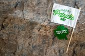 Happy St Patricks Day Flag With A Lucky Shamrock. Concept For St Patricks Day. Flatlay On Marble Bac poster
