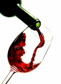 stock photo of wine-glass  - Photo of Red wine pouring into wine glass - JPG