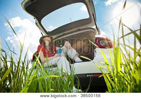 Young Woman Resting In Car